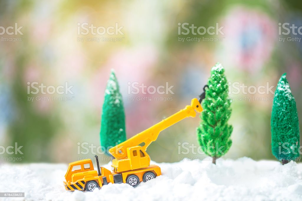 Miniature Christmas Tree and Truck on snow  over blurred bokeh background stock photo