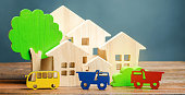 istock Miniature city. Children's figures and educational games. Wooden houses, trees and vehicles. The concept of urbanization. Growth and development of the urban environment. Traffic load. 1152623990