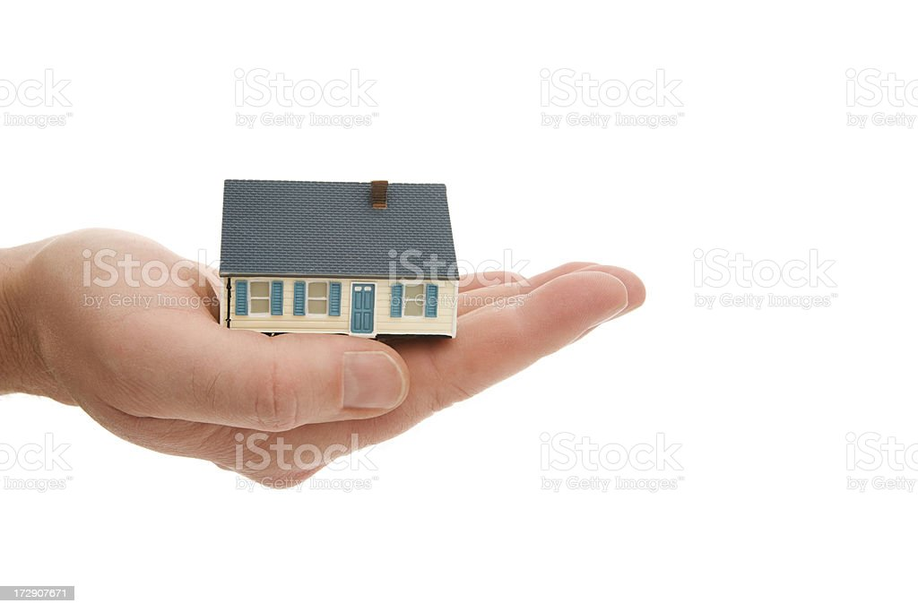 Miniature concept house on a male hand royalty-free stock photo