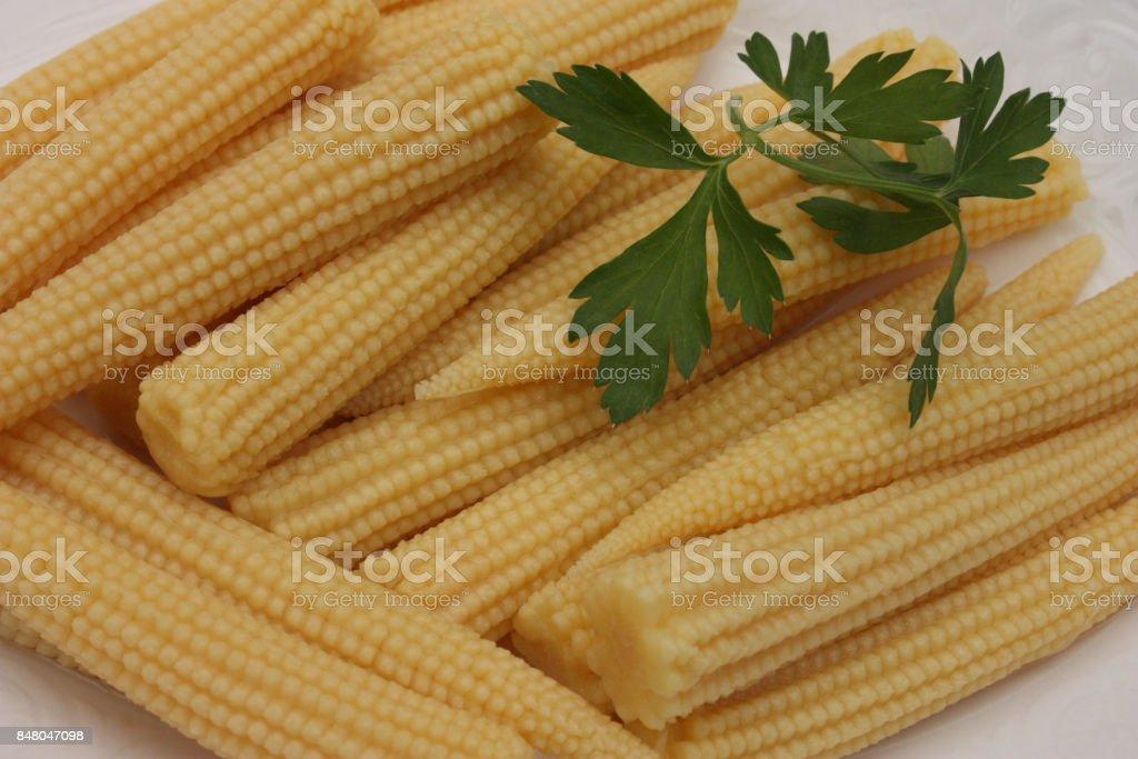 Miniature corn seasoning for aperitif stock photo