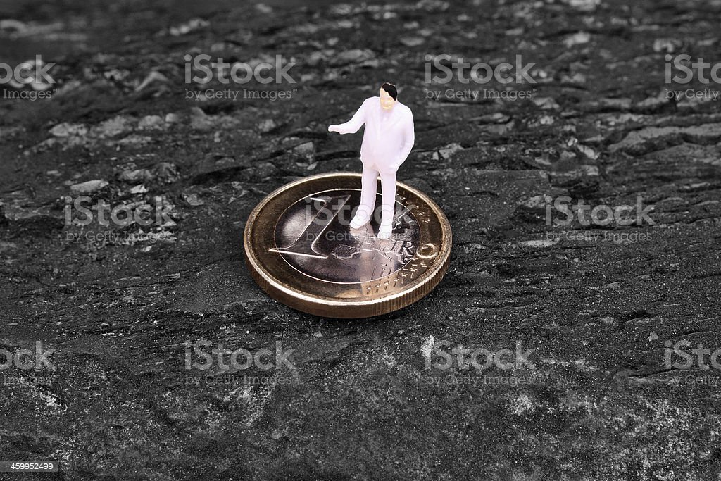 Miniature figure businessman  on euro stock photo