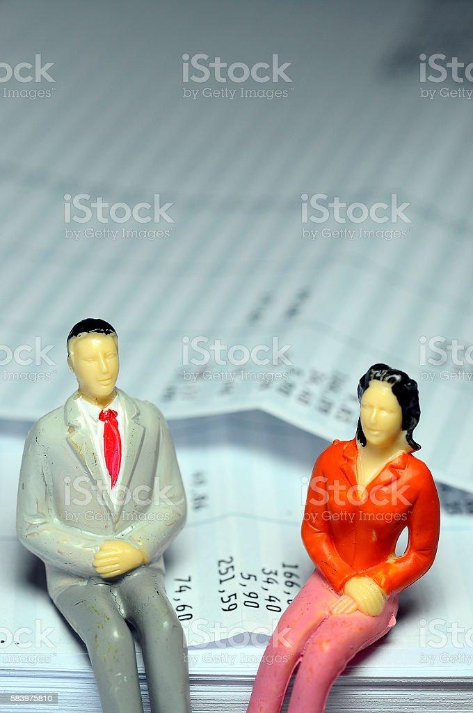 Miniature figure sitting on payroll stock photo