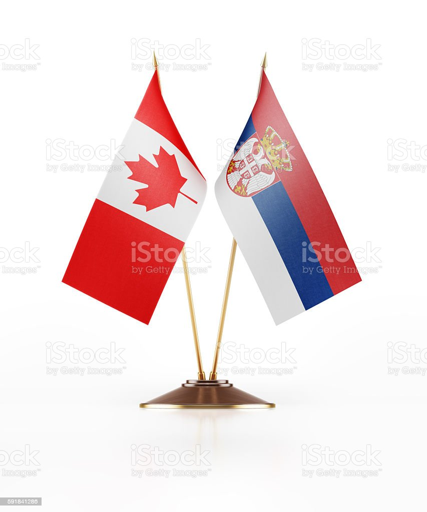 Miniature Flag of Canada and Serbia - fotografia de stock