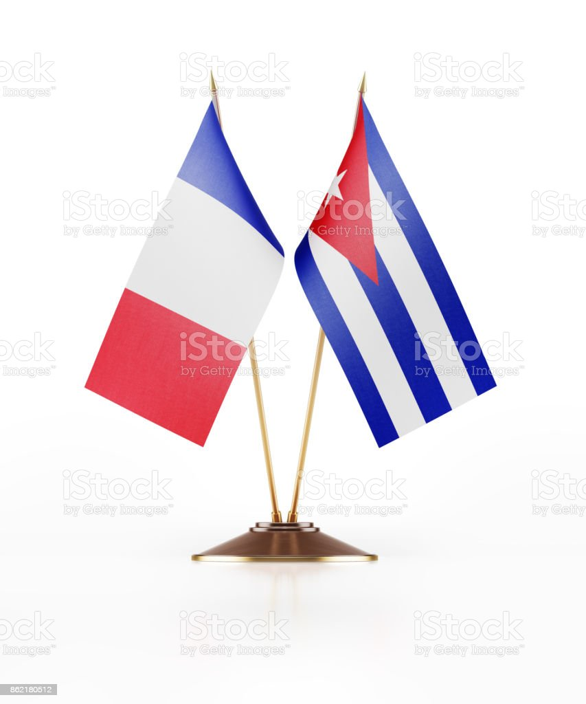 Miniature Flags Of France and Cuba On White Background stock photo