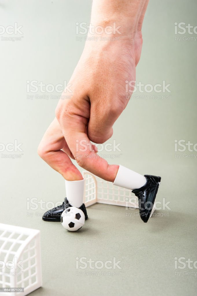 Miniature football game with human fingers stock photo
