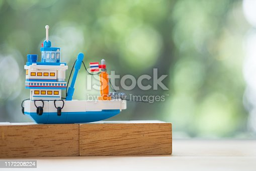 istock Miniature generic Thai fishing ship or tourist ship modified from fishing ship for go to destination. Travel in Thailand 1172208224