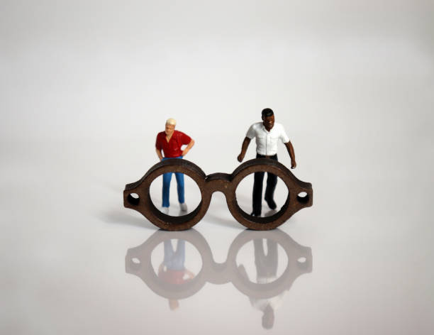 Miniature glasses and miniature people. Miniature glasses and miniature people. discriminatory stock pictures, royalty-free photos & images