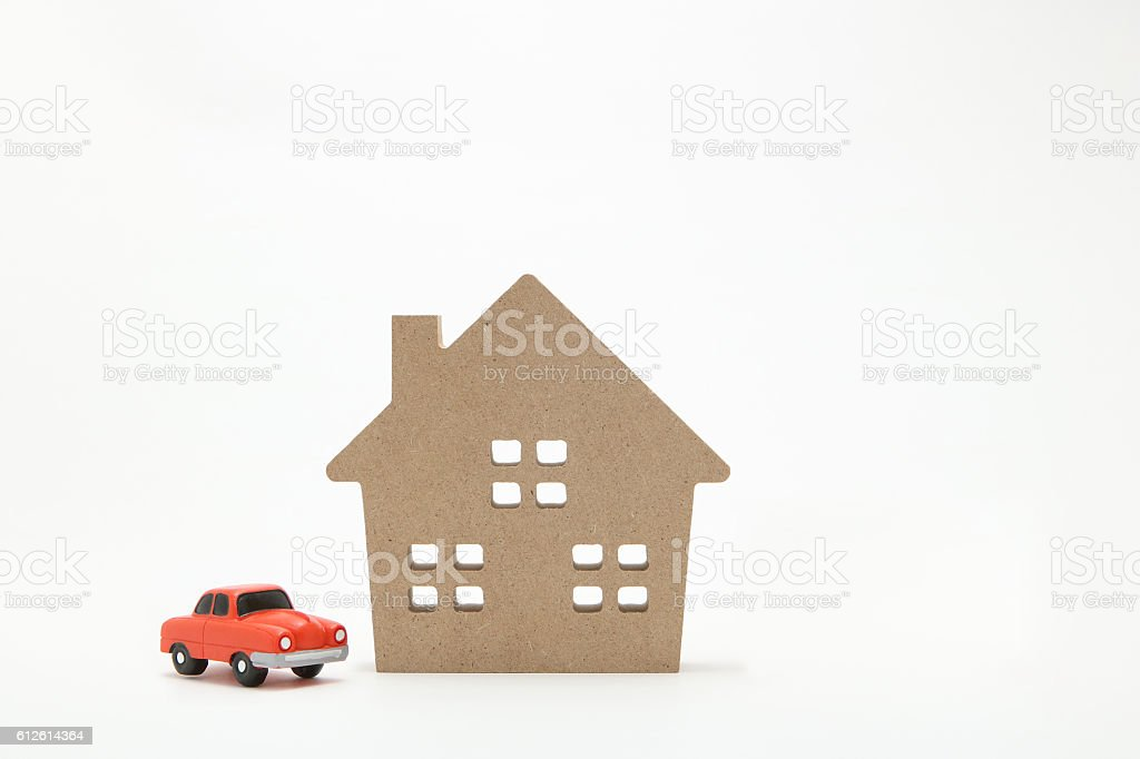 Miniature house and car on white background. stock photo