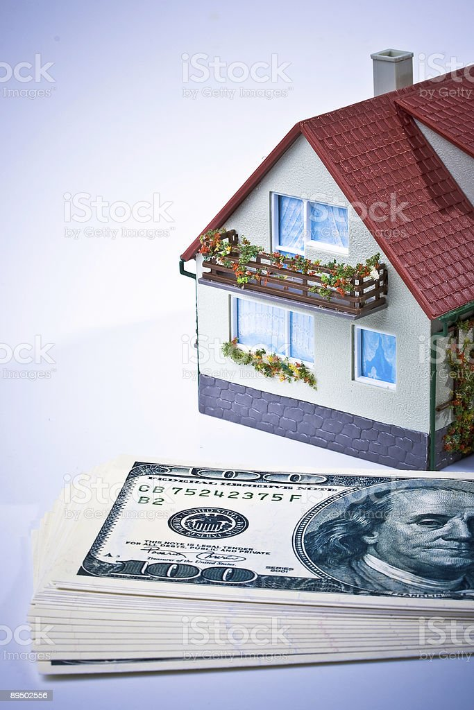 Miniature House and Money. royalty-free stock photo
