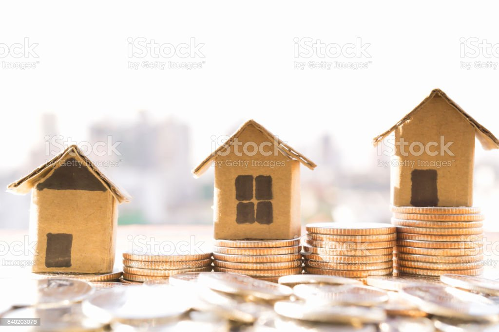 Miniature House Model And Financial Statement With Coins
