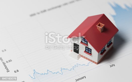 istock Miniature House on A Blue Financial Graph 640163076