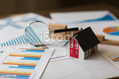 Miniature House on A Financial Graph