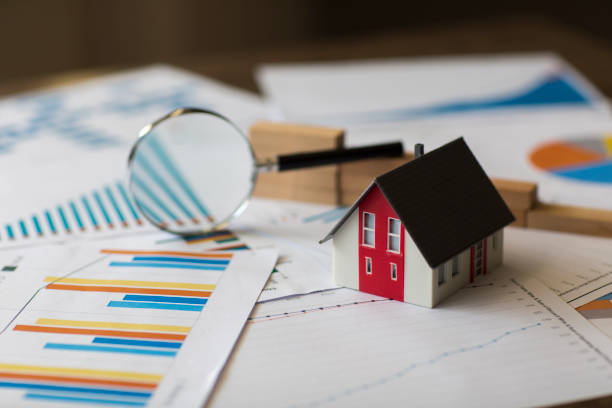 Miniature House on A Financial Graph stock photo