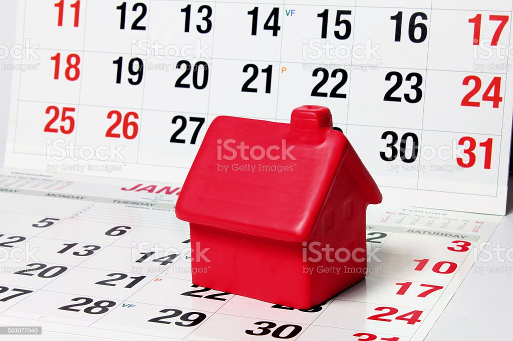 Miniature House on Calendar Pages stock photo