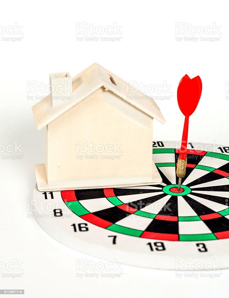 Miniature house on dart board stock photo