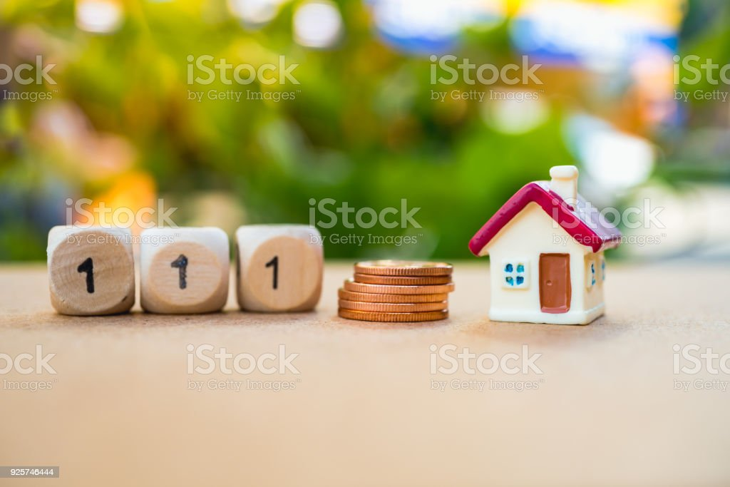 Miniature house with wooden block number stock photo