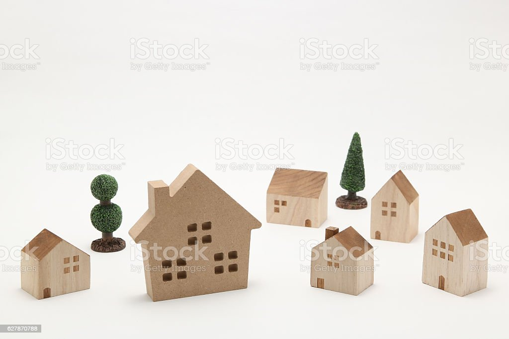 Miniature houses and trees on white background. stock photo