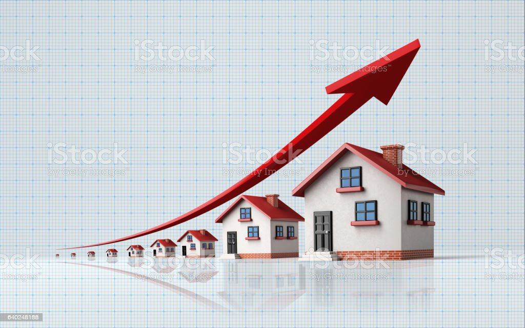 Miniature Houses on  Blue Graph Paper stock photo