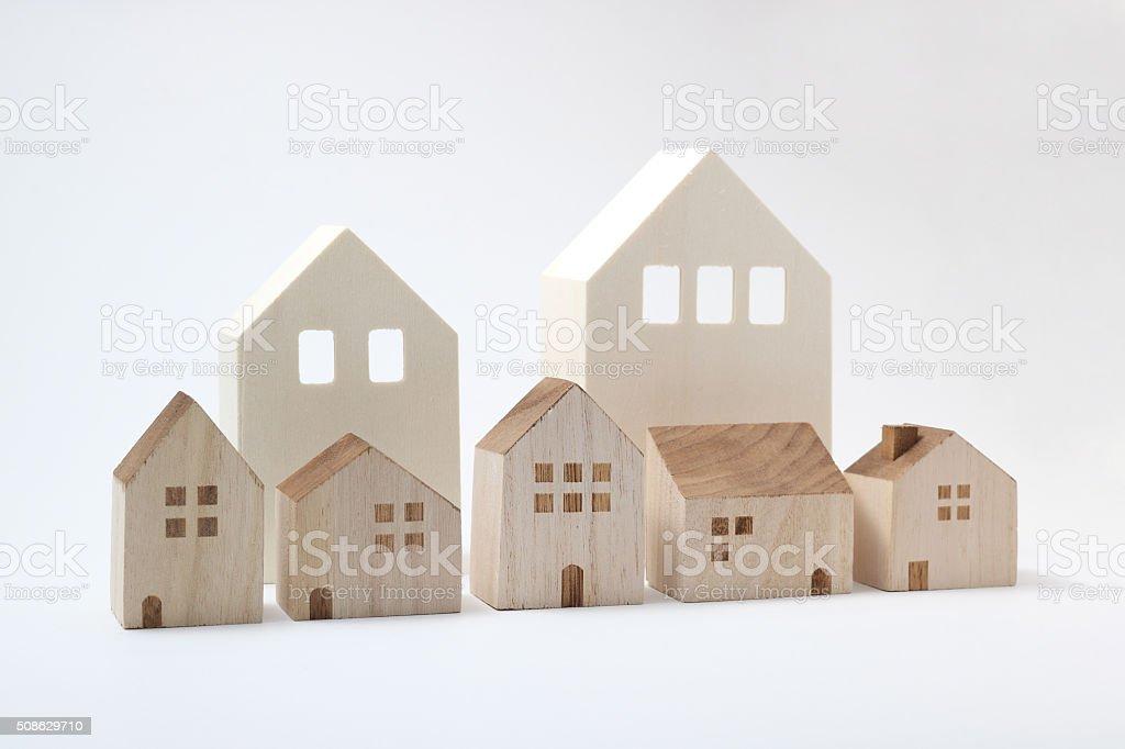 Miniature houses on white background stock photo