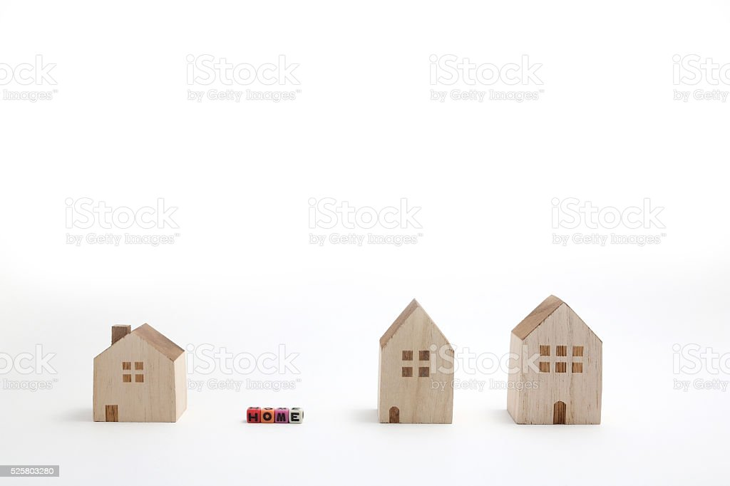 Miniature houses with alphabet blocks that spell home. stock photo
