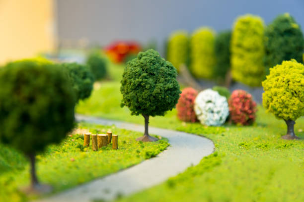 miniature landscape of a park - figurine stock photos and pictures