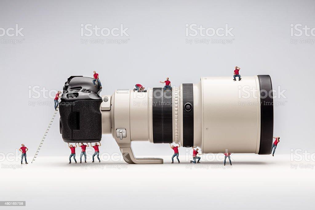 Miniature man and camera. Macro photo stock photo