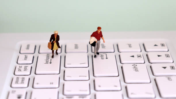 A miniature man walking on top of an enter key and a miniature woman walking on top of a backspace key. The male and female employment gap concept. A miniature man walking on top of an enter key and a miniature woman walking on top of a backspace key. The male and female employment gap concept. discriminatory stock pictures, royalty-free photos & images