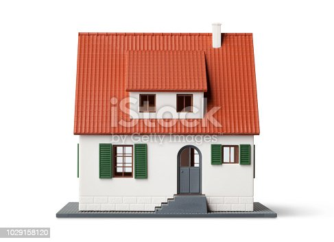 Miniature model house on white background.