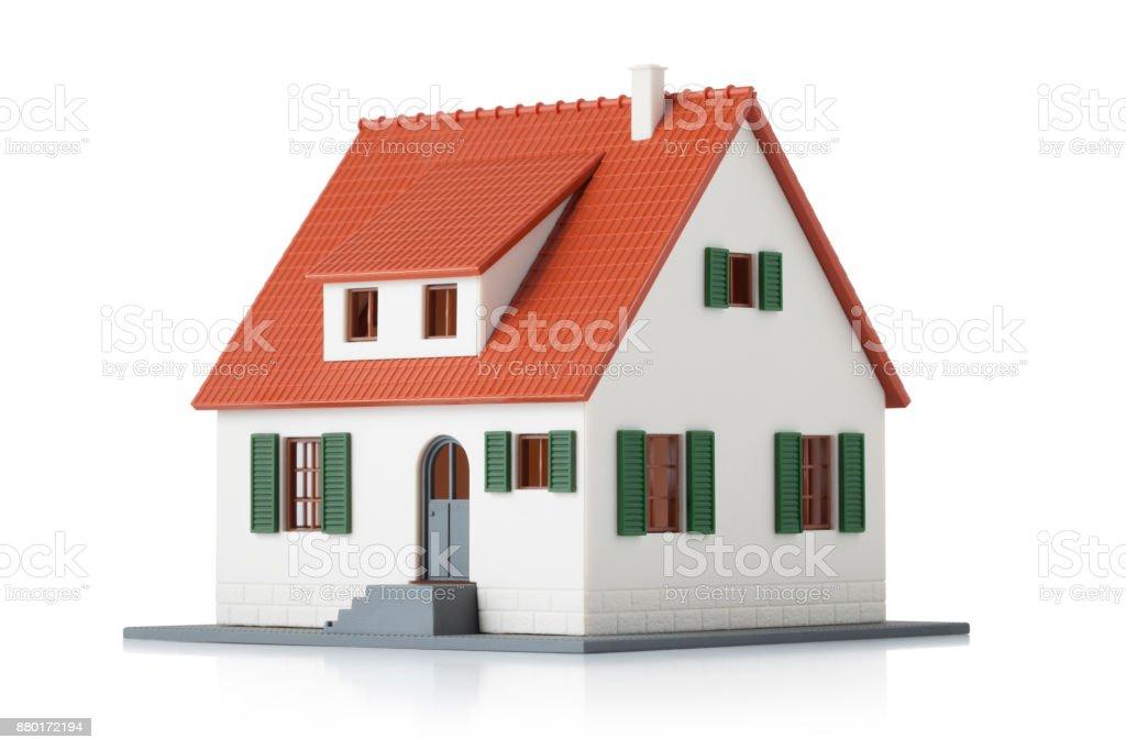 Miniature model house on white background stock photo