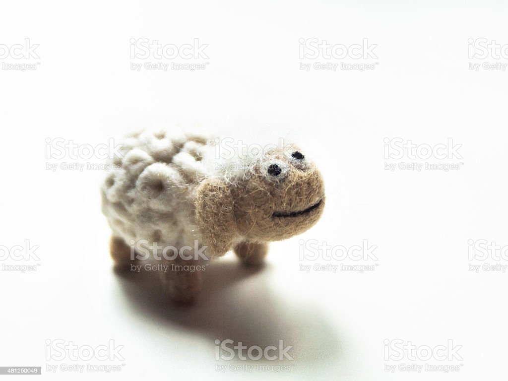 Miniature needle felted sheep, wool handmade toy stock photo