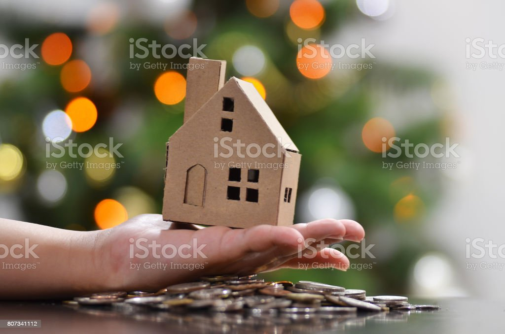 Miniature paper house stand on a hand stock photo