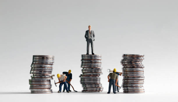 Miniature people and three pile of coins. Miniature people and three pile of coins. unbalanced stock pictures, royalty-free photos & images