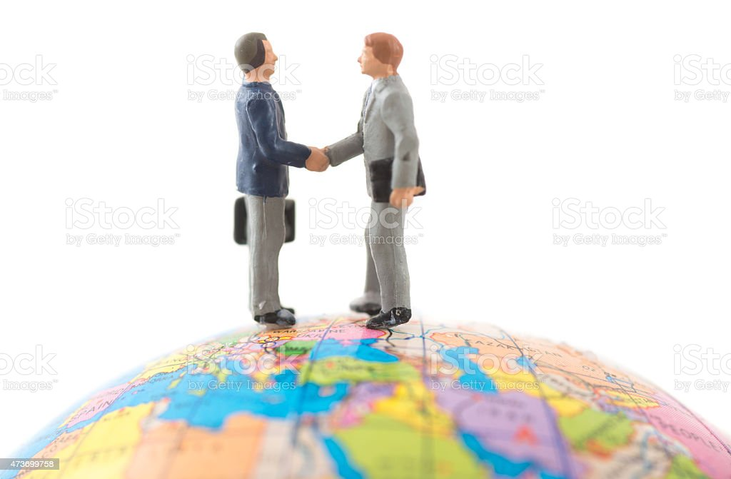 miniature people on map - business travel stock photo