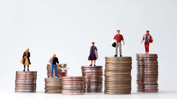 Miniature people standing on piles of different heights of coins. The concepts of person and wealth. Miniature people standing on piles of different heights of coins. The concepts of person and wealth. unbalanced stock pictures, royalty-free photos & images