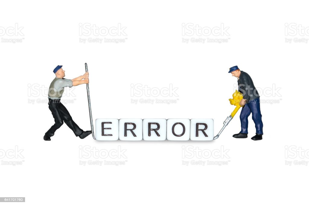 Miniature people. The word error of the cubes. Miniature workers stock photo