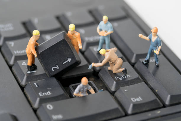 miniature people work on computer keyboard - figurine stock photos and pictures