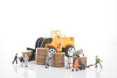 miniature people workers on money coin piles. business invesment and finance concept.