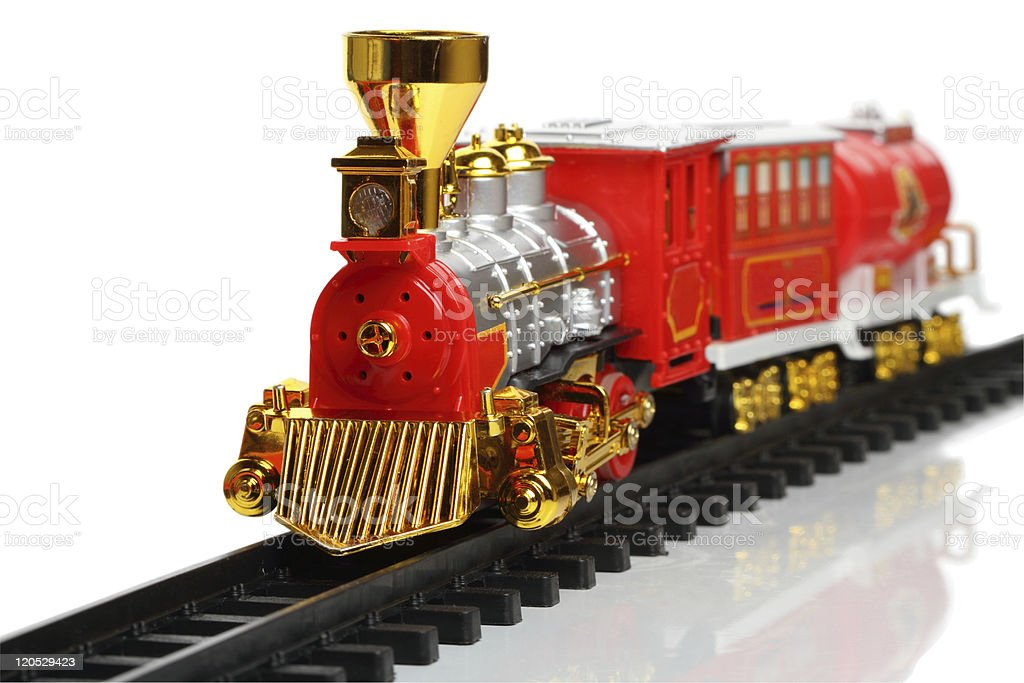 Miniature red and gold train on track stock photo