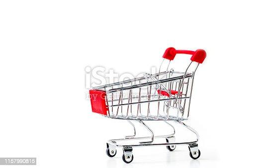 istock Miniature shopping cart isolated on white background. 1157990815