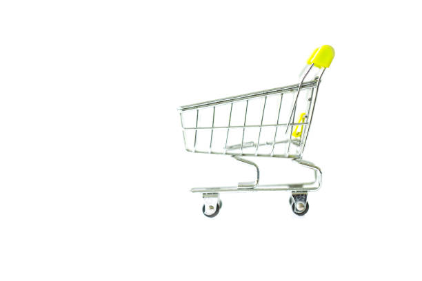 Miniature shopping cart isolated on white background. stock photo