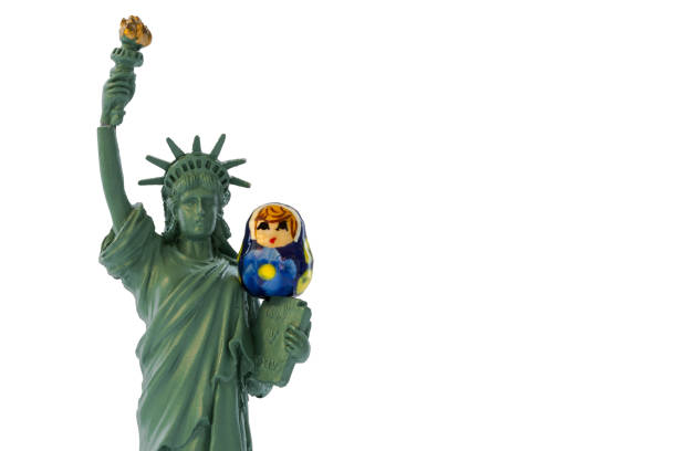 Miniature statue of liberty with a Russian babushka or matryoshka doll sitting on her Miniature statue of liberty with a Russian babushka or matryoshka doll sitting on her michael flynn stock pictures, royalty-free photos & images