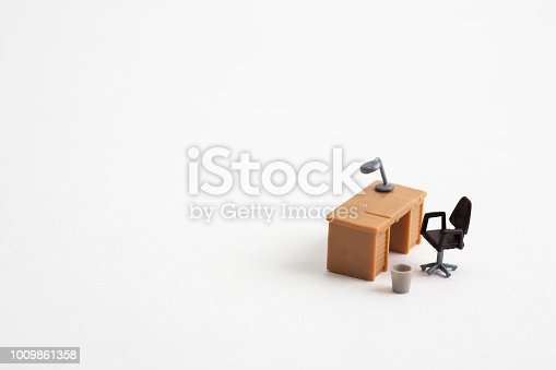 miniature table and chair on white background.