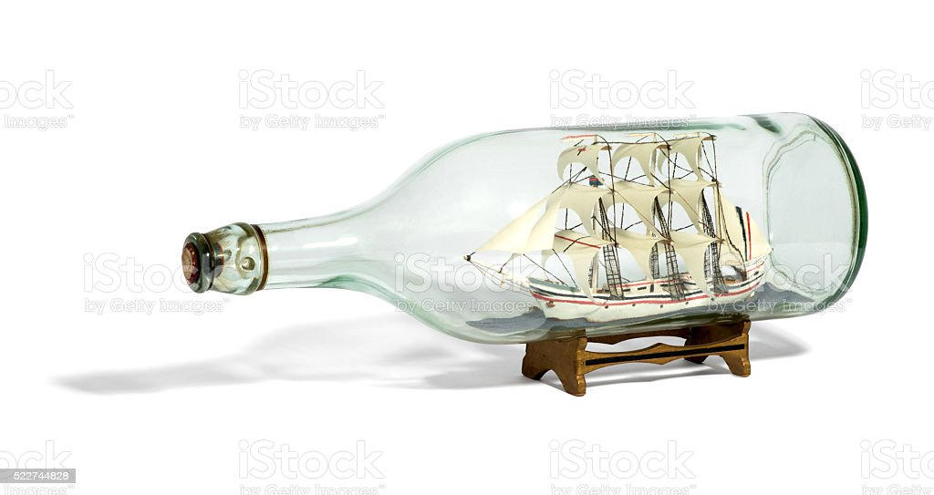 Miniature tall ship with sails rigged in a bottle stock photo