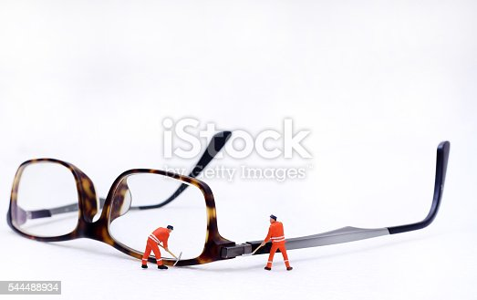 istock Miniature technician repairing  glasses 544488934