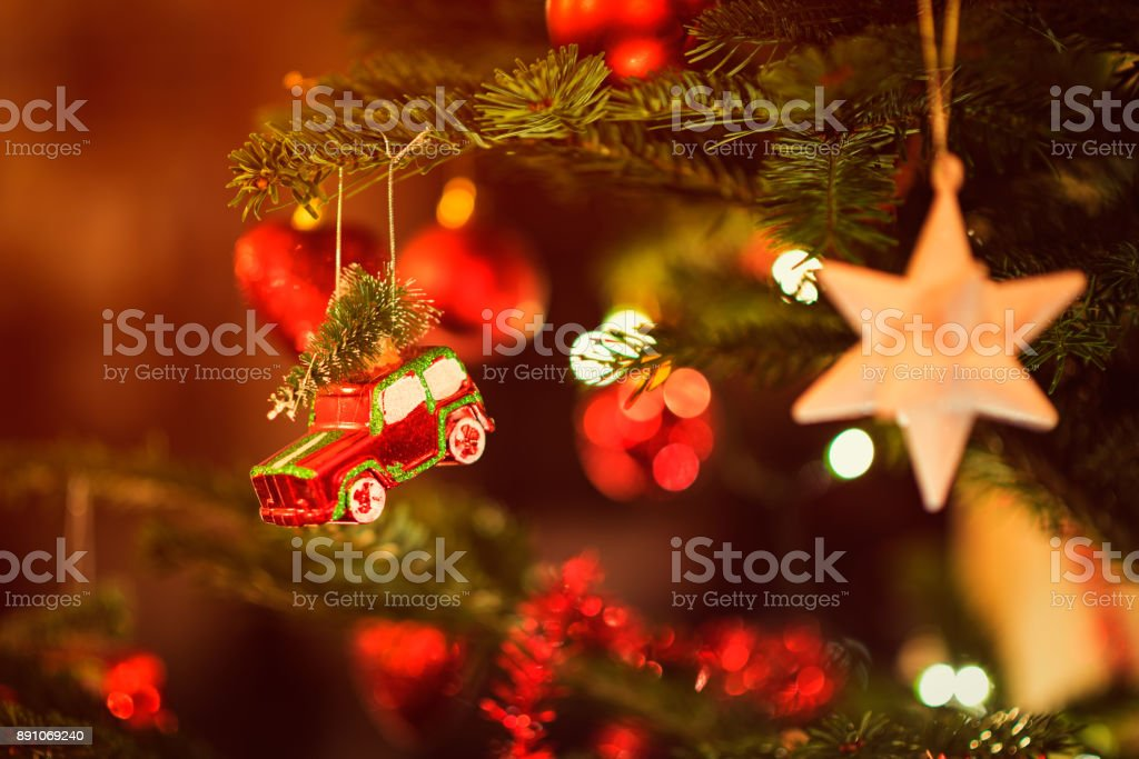 Miniature Toy Car hanging in Christmas Tree stock photo