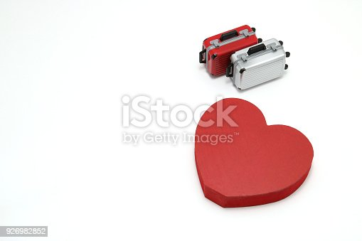 istock Miniature two suitcases and a red heart on white background. Concept of honeymoon. 926982852