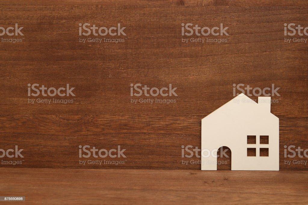 Miniature white house on wood. stock photo
