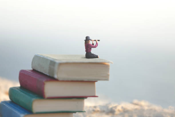 miniature woman looks at the infinity with the spyglass on a scale of books - fairy tale stock pictures, royalty-free photos & images