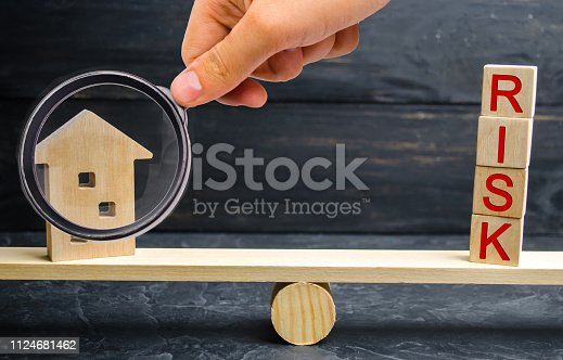 istock Miniature wooden house and the inscription