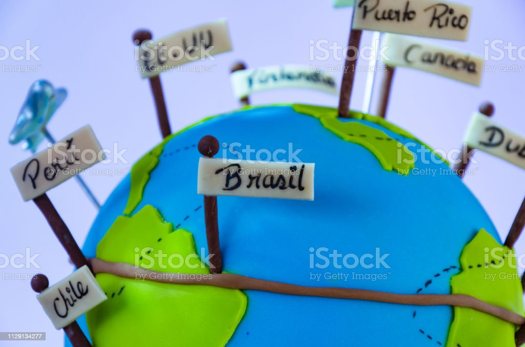 Miniature world with pennants of different countries and small plane,...